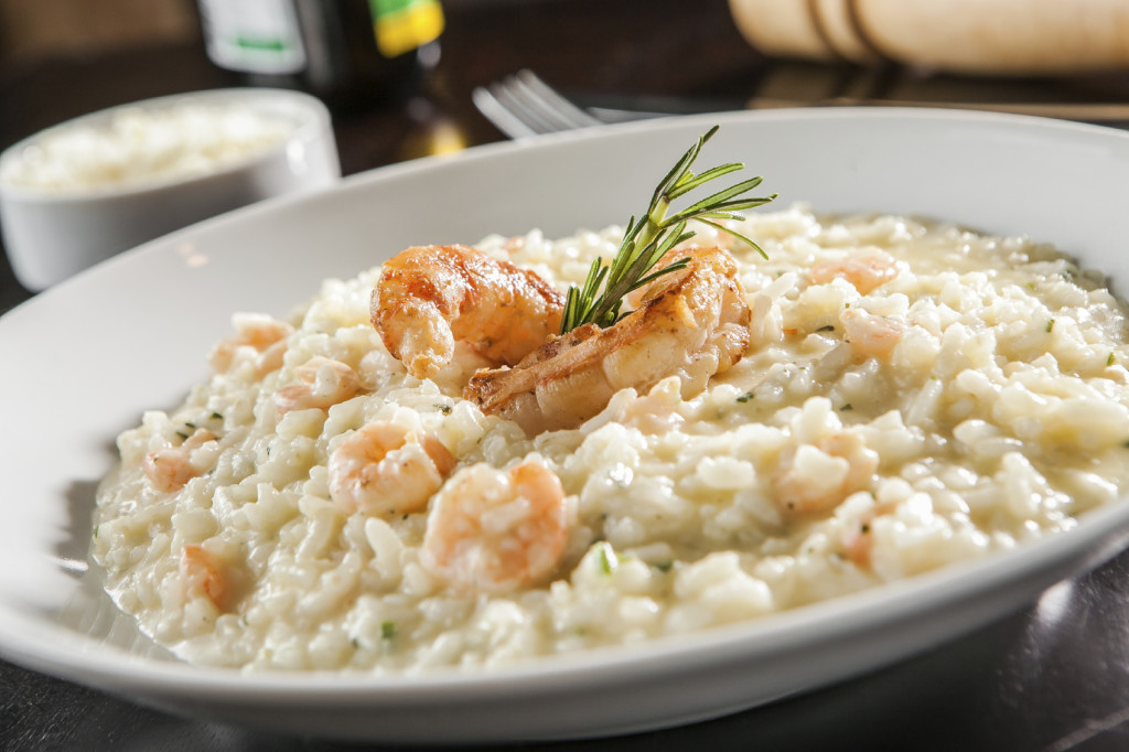 Shrimp risotto served at the table